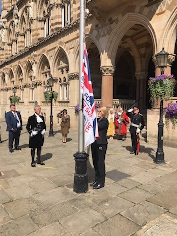Our director, Jane Chappell attends a flag raising ceremony in Northampton